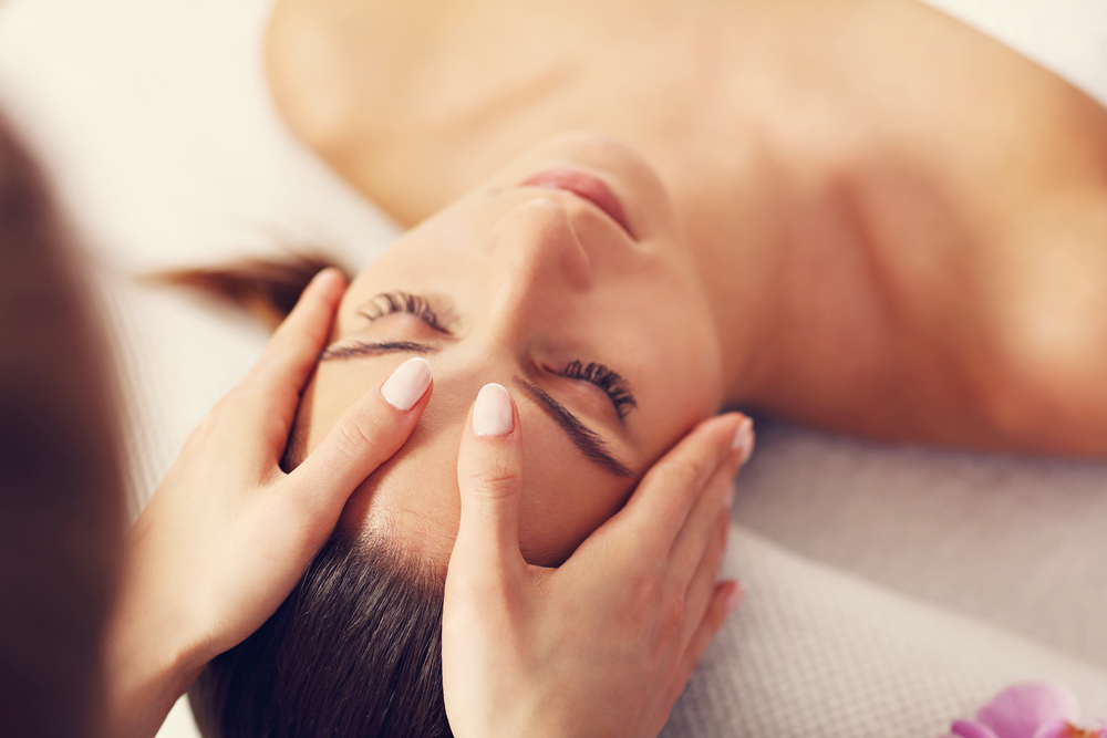 Women receiving massage therapy for sinuses