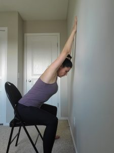 Seated shoulder stretch to wall